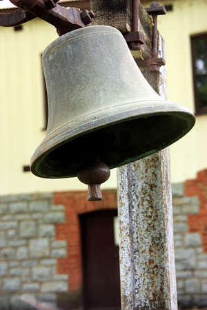 to sway: a Picture of a very old bell hanging on a dairy farm Stock Photo
