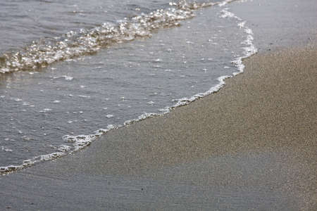 inflow: Sea wave on sand