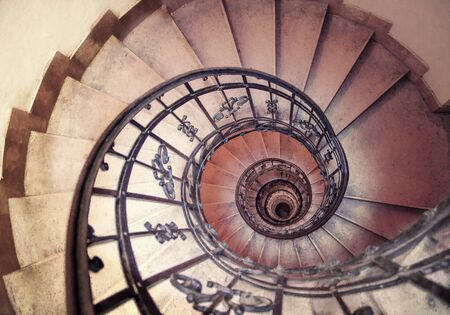 spiral staircase in an old house. spiral staircases architectural element of a historic building Stock Photo
