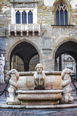 Beautiful old fountain in the center of Bergamo in Italy. Stock Photo
