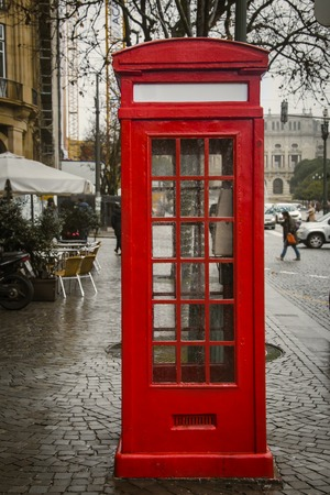Red telephone booth. Tourist guide in Porto, Portugal