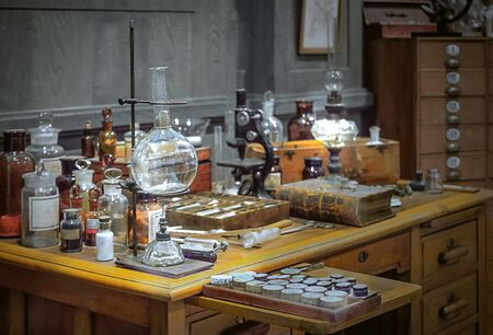 Old science lab with chemical reagents and burner.