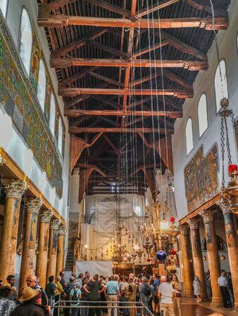 Bethlehem, Palestine - November 2019: Tourists in the Basilica of the Nativity