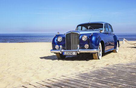 Beautiful blue retro car on the coast.