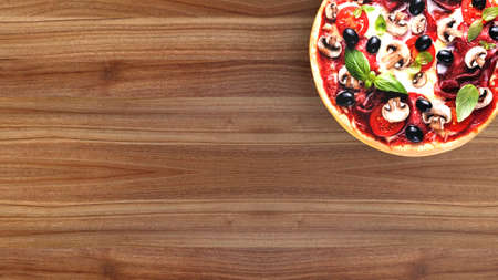Pizza with salami and olives on wooden table