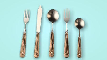 Steel cutlery on green Фото со стока