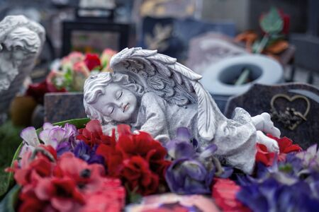 sleeping stoned angel at cemetery,grave angel statue