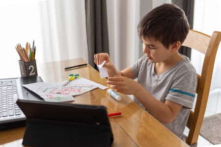 distance learning online, boy studying from home, kids using technology, homeschool education Фото со стока - 147262021