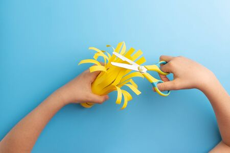 toilet paper roll craft concept for kid and kindergarten, DIY, tutorial, step by step instruction, step3, kids hands hands cut with scissors