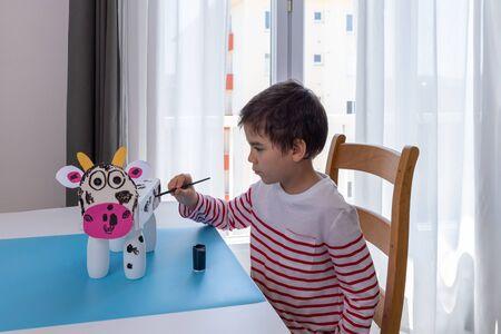 boy makes easy cow paper craft, kids hands make paper craft, leisure, activity for preschooler