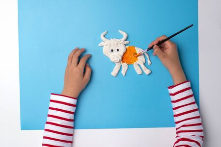 ox or bull modelling clay or salty dough craft concept for kid and kindergarten, year of the ox, how to make bull, step by step instruction, tutorial, DIY, step3, barnyard animal, colorize, kids hands