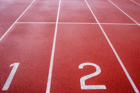 the number at start point of running track or athlete track in stadium, running court, red synthetic rubber surface on athletic stadium