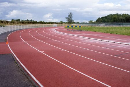 white lines of stadium and texture of running racetrack red rubber Фото со стока