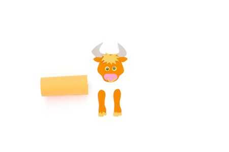 ox or bull toilet paper roll craft concept for kid and kindergarten, year of the ox, how to make bull, step by step instruction, tutorial, DIY, project step2, glue rectangular piece to tube, assambley all small details together Фото со стока - 150025183