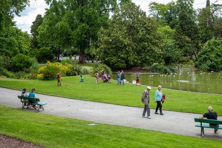 Angers, Maine et Loire/ France - June 20 2020: people walk in a public park after quarantine, social distancing