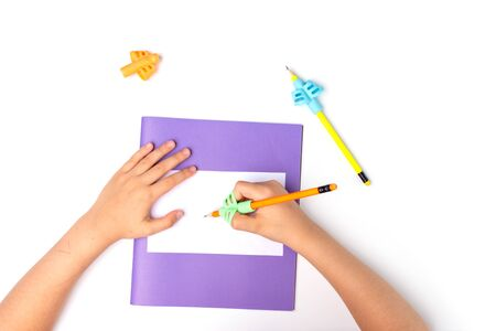 ergonomic training pencil holder, preschooler handwriting, kids learning how to hold a pencil, finger exercise, back to school, kid hands sign a notebook