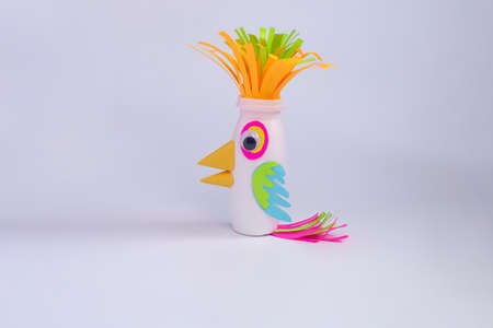 simple parrot craft for kids, colorful creative bird, reused yogurt bottle, activity ideas for preshooler Фото со стока - 151517255