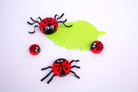 easy plastic cap kids craft, ladybug art project, DIY, step 2, kindergarten and school of creativity, activity for preschooler kids, simple craft from bottle cap Фото со стока - 152267095