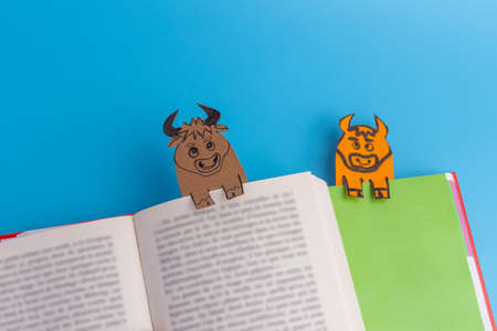 book with paper cow or bull bookmarks , soft focus, year of ox easy craft for kids Фото со стока - 152485840