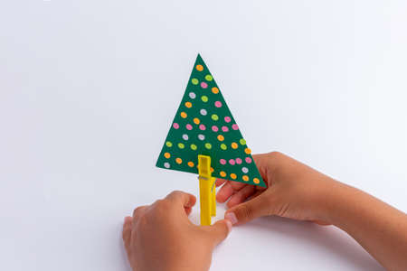 childrens creativity. handicraft from improvised means. Christmas tree craft. simple and cheap. activity for the child. kids hands