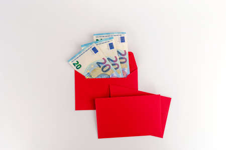 red envelope with euro money inside, Christmas flat lay economy