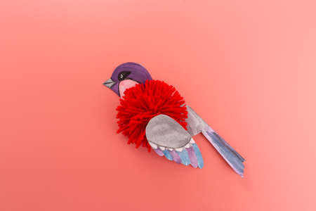 how to make bullfinch bird craft for children, flat lay, pink background