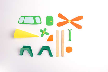 multi-colored paper parts to make a helicopter craft, activity for kids