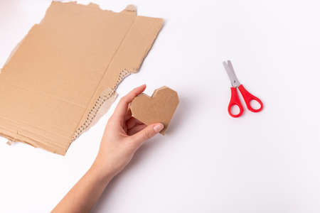 hands make a valentine craft, abstract cardboard heart