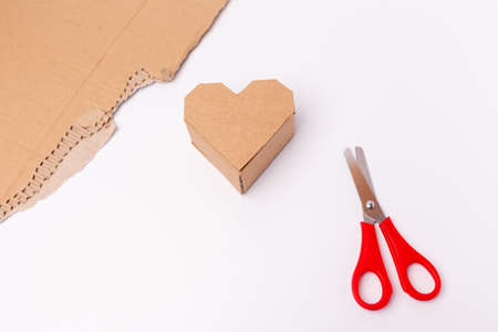 heart made of cardboard craft for san valentine day, recycling upcycling concept, minimalism, DIY