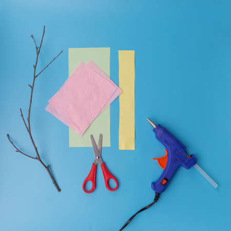 materials for crafts, how to make a tree branch with flowers, step by step instruction, DIY, spring or easter craft activity for kids