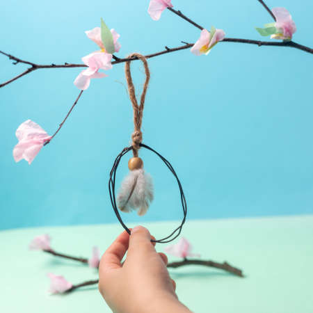 lovely easter interior decoration made of wire, simple DIY, spring craft for kids, Фото со стока
