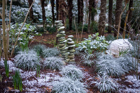 a pile of rocks in garden covered with snow