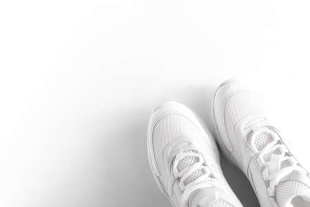 part of white sneakers on white background, top view, Active lifestyle. Summer concept.