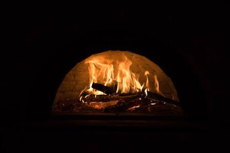 devouring: fire fireplace Stock Photo