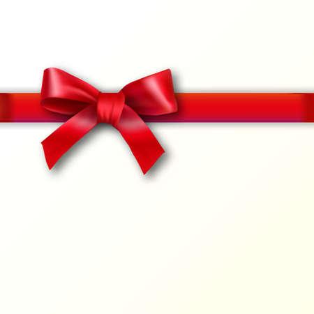 Geschenkkarte mit rotem Band und Bogen auf einem weißen Sahnehintergrund.