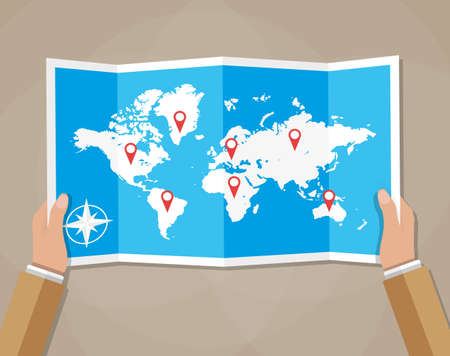 Cartoon hands hold folded paper map of world with color point markers. World map countries. vector illustration in flat design on brown background Ilustração