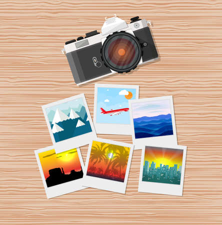 Wooden travelers desk with photos and camera. travel and vacation concept.