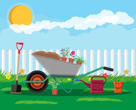 Formal garden with wheelbarrow, flowers, shovel