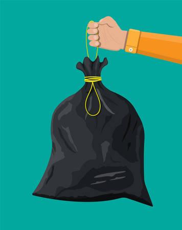 Sacco della spazzatura di plastica con la corda in mano