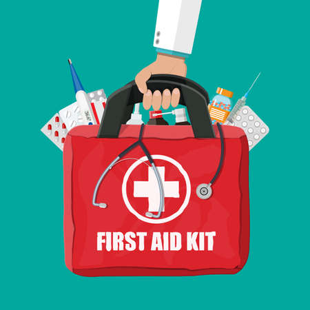 Medical first aid kit with pills and thermometer.