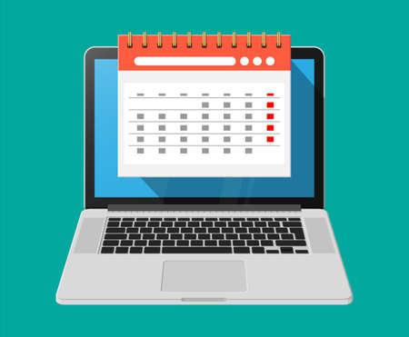 Calendario de pared de espiral de papel en la computadora portátil