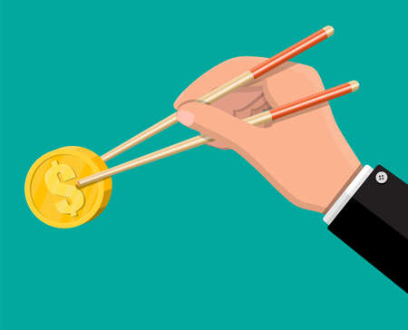 Hand of businessman with chopsticks with coin