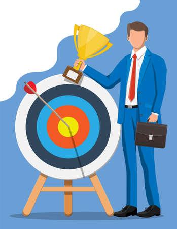 Businessman with trophy, dart target