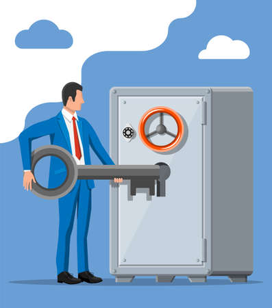 Businessman with key near vault room safe door.