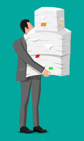 Stressed businessman with pile of office documents