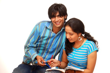 indian college student: boy and girl studying  over a white background