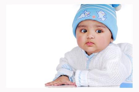 indian child: baby lying wearing woolen