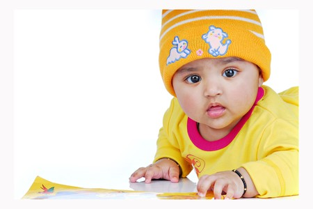 baby lying with book Stock Photo