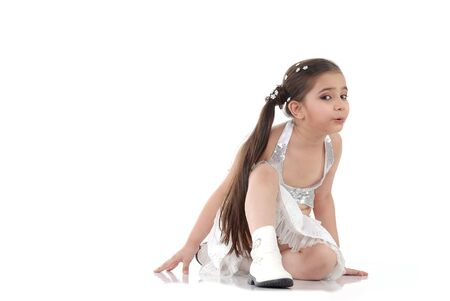 side pose: dancer giving pose on the floor over white background  Stock Photo