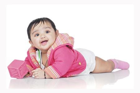 lying baby wearing pink dress